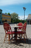 Outdoor restaurant table. Restaurant table at a city square Stock Photo