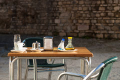 Outdoor restaurant table Royalty Free Stock Images