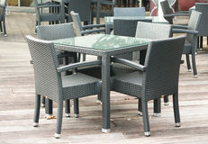 Outdoor restaurant table and chairs. Outdoor restaurant patio chairs and table Stock Images