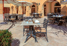 Outdoor restaurant tables and chairs. Royalty Free Stock Image