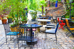 Outdoor restaurant tables with yellow chairs Stock Images