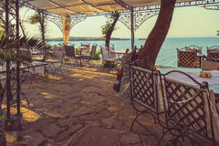 Outdoor restaurant. Toned picture of the outdoor restaurant with seaview Royalty Free Stock Photography