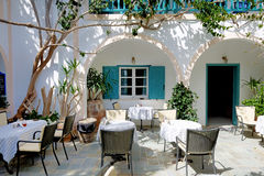 The outdoor restaurant in traditional Greek style Royalty Free Stock Photo