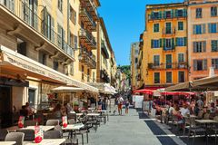 Outdoor restaurants on small street in Nice, France. Royalty Free Stock Images