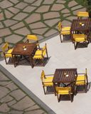 Outdoor resturant patio tables. Wooden tables on the outside patio at a restaurant Stock Images