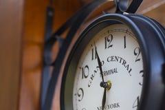 Outdoor retro analog clock on the wood wall stock photos