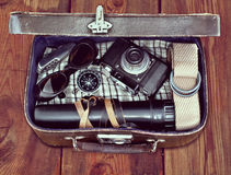 Outdoor retro suitcase with things the traveler Royalty Free Stock Photography