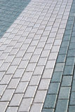 Outdoor road gray stone tiles closeup Stock Photos