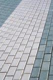 Outdoor road gray stone tiles closeup Stock Photos