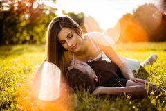 Outdoor romance - young couple hugging Stock Photos