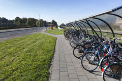 Outdoor roofed bicycle storage Stock Images