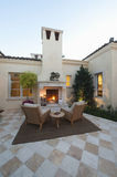 Outdoor Room At Dusk With Fireplace Stock Images