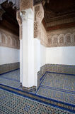 An outdoor room with a mosaic tiled floor and wood carvings in a palace in Morocco Stock Photo
