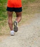 Outdoor runner. Muscled legs runner training outdoor Stock Image