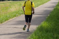 Outdoor running or cycling in sunny summer Stock Image