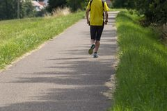 Outdoor running or cycling in sunny summer Royalty Free Stock Images