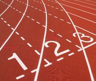 Outdoor Running Track. With white markings, using red tartan rubber royalty free stock photos