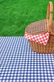 Outdoor Rustic Picnic Table With Hamper And Blue Tablecloth Stock Image