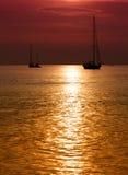 Sailboats at dusk Stock Photo
