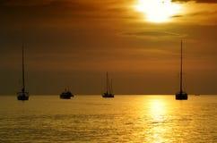 Sailboats at dusk Stock Photography
