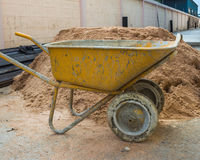 Outdoor sand. Vehicle used to put sand stone and mortar Royalty Free Stock Image