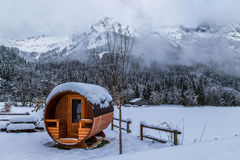 Outdoor sauna in the snowy alps Royalty Free Stock Photography