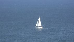 Sailboat sailing in ocean. An outdoor scene in nature stock footage