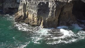 A Waves Hitting Rocks