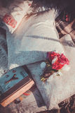 Outdoor scene with pillows, paris photo album and bouquette Royalty Free Stock Image