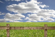Outdoor Scene With Wood Fence, Sky and Grass Stock Photos
