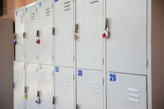 Outdoor school lockers. Grey outdoor school lockers with some locks on them stock images