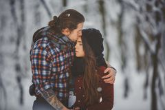 Outdoor seasonal activities couple walking in snowy winter forest Royalty Free Stock Photo