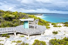 Outdoor seat right beside the beach, Kangaroo Island, Australia. Turquoise ceramic seat on private beach of Southern Ocean Lodge, Kangaroo Island Stock Photo