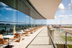 Outdoor seating at Gibraltar International Airport. Outdoor seating on a terrace on the Gibraltar International Airport in the British Overseas Territory of Stock Images