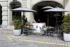 Outdoor seating restaurant on a cobbled sidewalk Stock Image