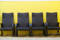 Outdoor Seating With Vivid Yellow Wall Stock Photo