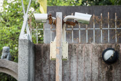 Outdoor Security Cameras on wooden pole Stock Images