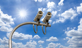 Outdoor Security cctv cameras. Under Sun shine and White cloud in blue sky Stock Photos