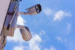 Outdoor security cctv cameras against blue sky and sunshine. Outdoor security cctv cameras against blue sky and sunshine Stock Image