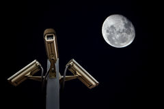 Outdoor security cctv cameras against night sky and moon.  Stock Photos