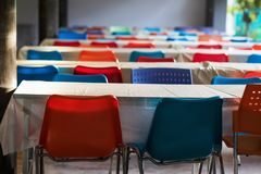 Outdoor seminar meeting room with color chairs. Colorfiul chairs with wooden table in outdoor seminar meeting room against sunlight Stock Images