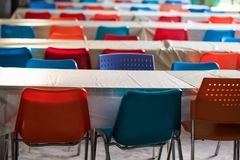 Outdoor seminar meeting table and chair. Seminar room. Colorfiul chairs with wooden table against sunlight Stock Image