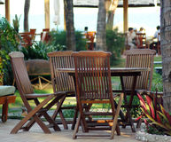 Outdoor setting. Of wooden chairs and table royalty free stock photos