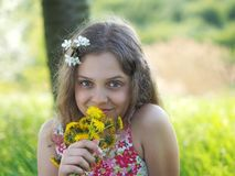 Outdoor little girl with bouquet of dandelions royalty free stock photos