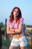 Outdoor shoot of a red hair woman royalty free stock photo