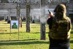 Outdoor shooting with a 9mm pistol. In a shooting range Royalty Free Stock Photos