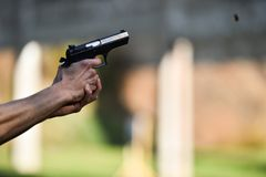 Outdoor shooting with a 9mm pistol. In a shooting range Royalty Free Stock Images