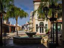Outdoor Shopping Mall Early Morning. Beautiful outdoor shopping mall in Orlando, Florida with palm trees, restaurants, boutique stores and special food shops.  A Royalty Free Stock Photos