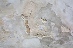 Outdoor shot of aged grey cement wall with cracks. Closeup texture stock image