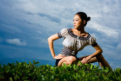 Outdoor shot of fashion model squatting Royalty Free Stock Images